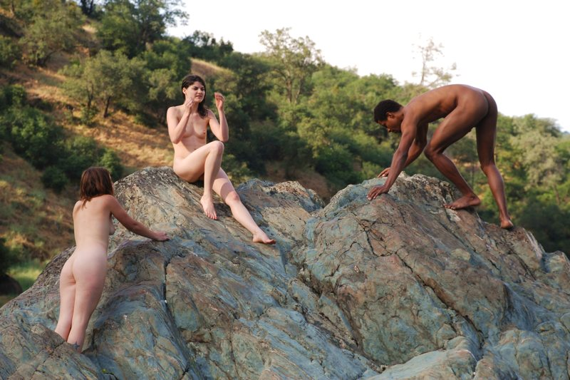 nudist climbing to the top