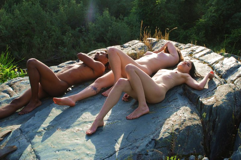 naturists sunbathe and rest